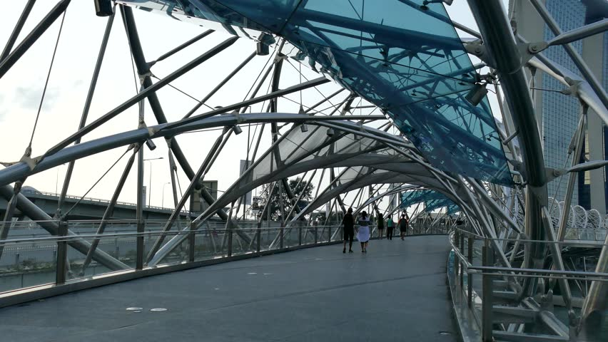 SINGAPORE - Circa April 2016: The Helix Bridge on August 21, 2011 in Singapore, is a pedestrian bridge linking Marina Centre with Marina South in the Marina Bay area in Singapore. #16564399