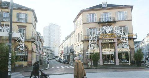 MULHOUSE, FRANCE - CIRCA 2015: Place de la Republique and Avenue du Marechal Foch with pedestrians and its beautiful architecture