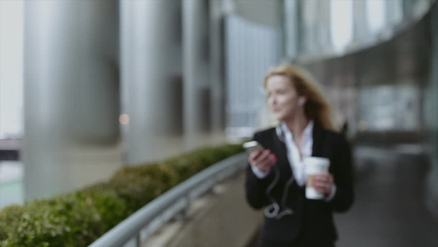 Young Businesswoman Walking and Texting on Smartphone in City, a Beautiful Girl With a Black Bag in Hand,a Beautiful Girl With a Phone in Chicago,a Beautiful Blonde Girl,beautiful Architecture | Shutterstock HD Video #16586929