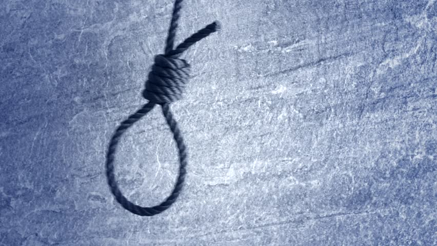 Noose hanging in front of stone wall film clip. Symbol of death, capital punishment and execution.