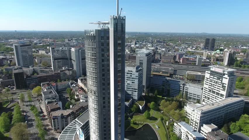CITY RUNDFLUG HALBE RUNDE HALF ROUND SKYSCRAPER OFFICE BUILDINGS IN ESSEN GERMANY RUHRVALLY INCLUDING THE RWE TOWER CENTRAL STATION HAUPTBAHNHOF STADT RUHRGEBIET ESSEN SUNNY DAY SONNIGER TAG