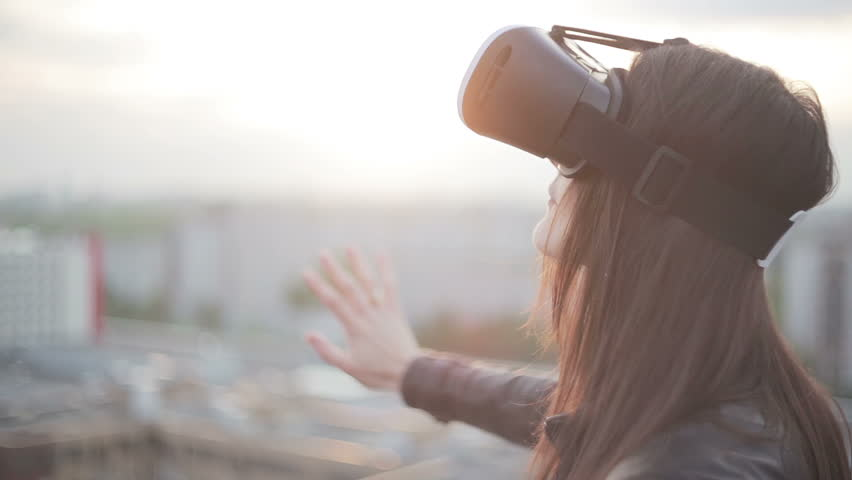 woman uses a virtual reality glasses on the roof | Shutterstock Video #16620757