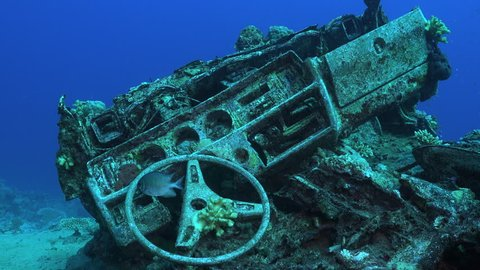 Underwater car wreck - Toyota reef, Blue bell cargo shipwreck - Red sea, Sudan. Vehicles wreck in undersea.