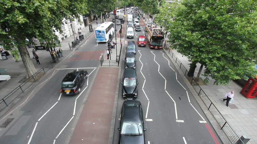 LONDON, UK - JULY 25: Big Bus tourist coach and other traffic on Victoria Embankment on July 25, 2011 in London, UK. Victoria Embankment runs along the Thames from Westminster to Blackfriars Bridge.