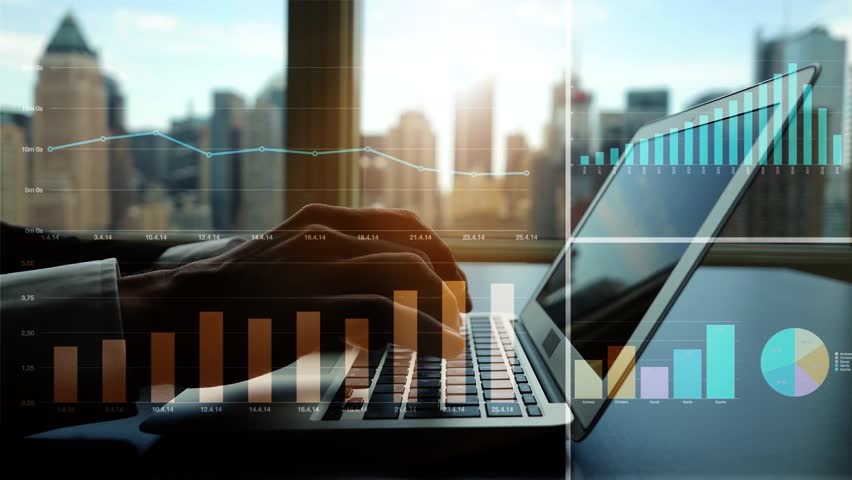 Working on laptop computer in modern office desk analyzing financial  profits progress. business charts diagrams background. online banking from home. city skyline window view  | Shutterstock HD Video #16830703