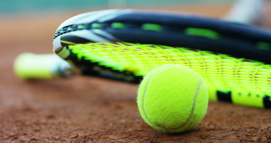 slow motion of  tennis professional racket and field in red soil background with tennis player defocus  #16869979