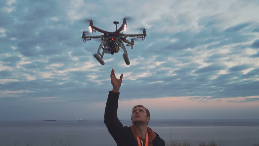Hexacopter drone lands on your hands #16895509