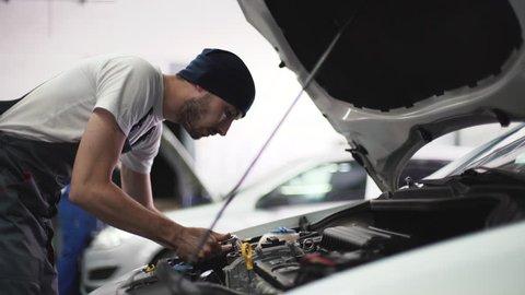 Auto mechanic repair engine in a car repair shop
