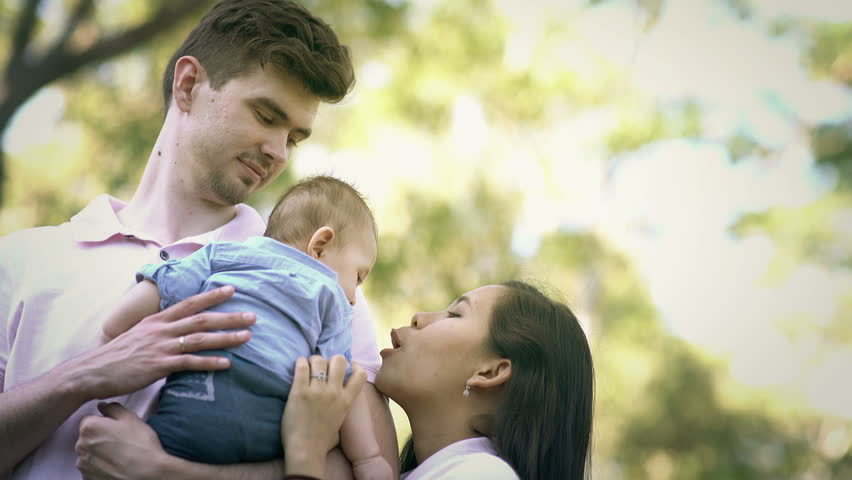 Close up of Young Mixed Race Couple Playing with Their Son in The Forest | Shutterstock HD Video #16917229