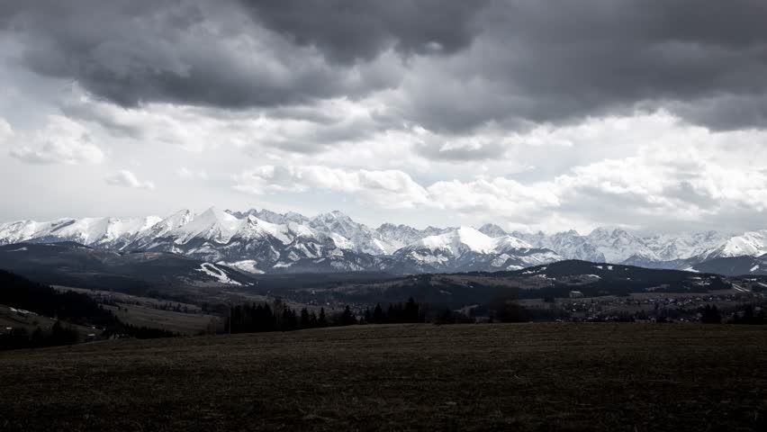 4K Timelapse of storm clouds over mountains