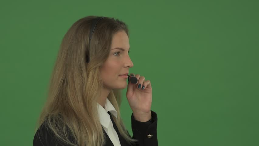 Female executive assisting client over the call | Shutterstock HD Video #16984714