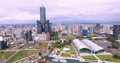 Aerial view of the city in Kaohsiung - Taiwan/Aerial shot of Tuntex Sky Tower and the exhibition center in Kaohsiung, Taiwan