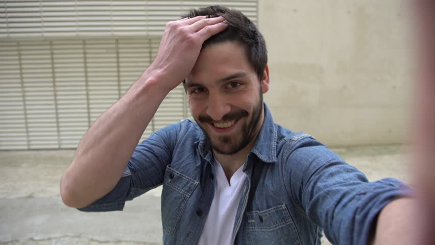 Paris, France - April 14, 2016: Man posing for a selfie | Shutterstock HD Video #16996693