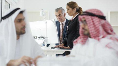 4K Smiling Arab businessmen shake hands in meeting. Shot on RED Epic. UK - April, 2016