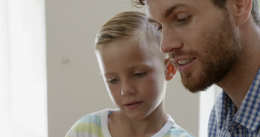 Close up view of father and son talking in the sitting room | Shutterstock HD Video #17035249
