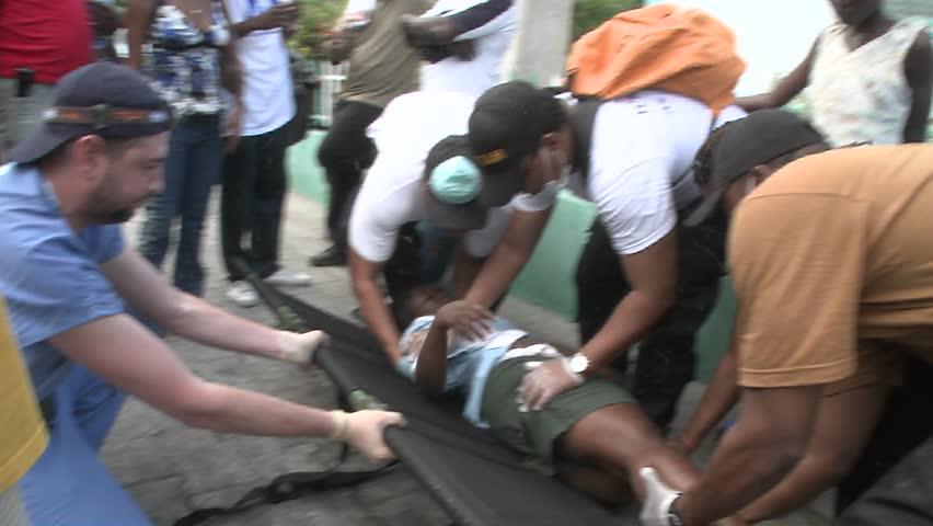 PORT-AU PRINCE, HAITI - CIRCA 2010: people carrying an injured person circa 2010 in Haiti.