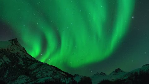 Time lapse clip of Polar Light or Northern Light (Aurora Borealis) in the night sky over the Lofoten islands in Norway in winter. Cinemagraph clip.