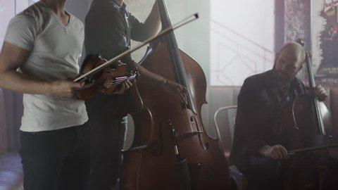 Medium shot of strings trio playing in bar / Salt Lake City, Utah, United States