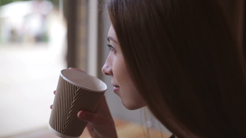 Woman drinking coffee in restaurant or cafe #17089192