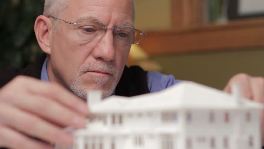 Architect looking at model of a home