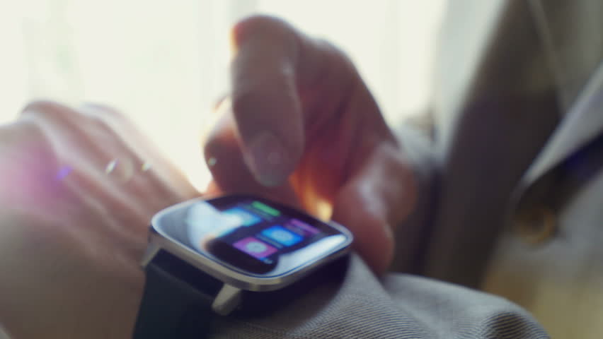 Man using his smart watch device. Close-up hands.