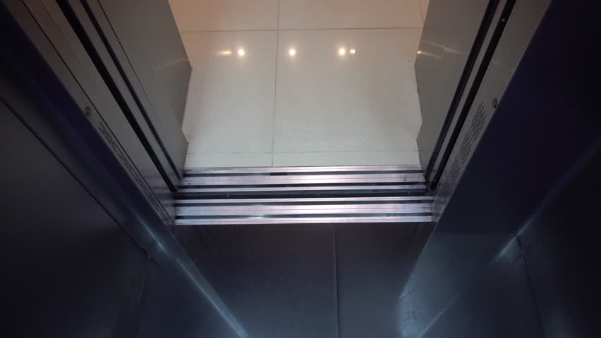 Steel Elevator Door, the Elevator Automatically Closes, Business Center Floor White Door Has Two Parts, Floor Tiles, Light Reflection, 4k
