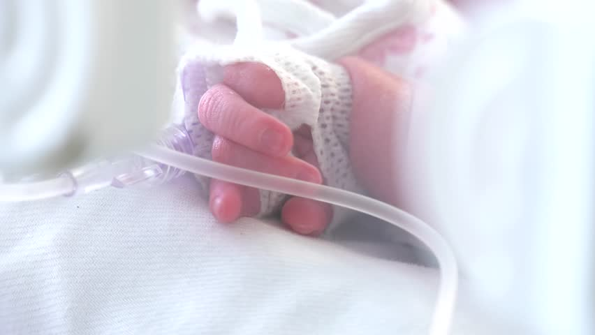 smal child in incubator , hospital , little feet and hand a newborn baby and newborn babies sleepiing at nursery,Neonatology,Cared doctor neonatologist  Medical devices cardiogram cannula tube.