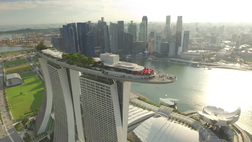 SINGAPORE, MAY 2016: Travelling aerial shot of Marina Bay Sands with Singapore City Skyline as background - May 2016 (Singapore)