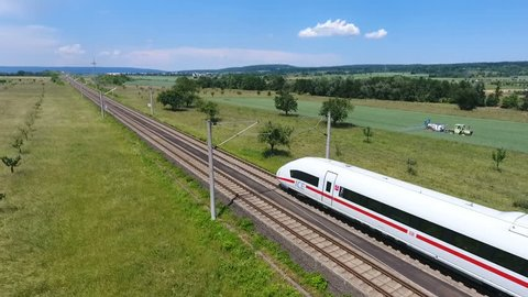 Wallau, Germany - June 07, 2016: Aerial tracking shot of passing german high speed train (ICE) on the Frankfurt-Cologne line near Wallau, Germany. The maximum speed of these trains is around 320km/h