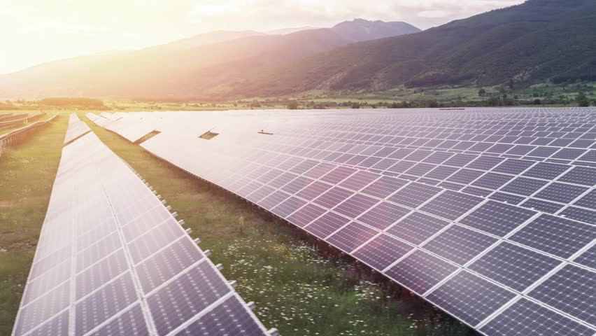 Solar Panels Farm Green Energy Aerial Flight At Sunset Orange Colors Mountains Nature Ecology Concept