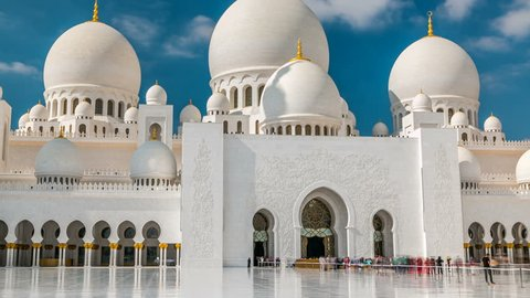Sheikh Zayed Grand Mosque timelapse located in Abu Dhabi. Mosque was initiated by late President of UAE Sheikh Zayed bin Sultan Al Nahyan. It is largest mosque in UAE. Blue cloudy sky