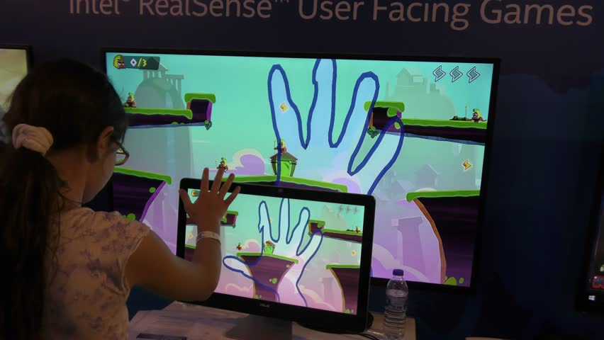 JERUSALEM, ISRAEL - APRIL 26, 2016: A child plays computer game with Intel's RealSense technology for facial, expression and Finger Gesture recognition, emotion tracking, during Geek PicNic festival