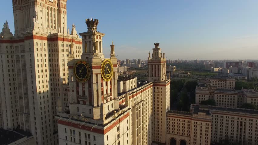 Helicopter flight over MSU Moscow State University. Close approach to clock. Moscow city center and Luzhniki stadium at background. Ultra HD 4K. Best footage.