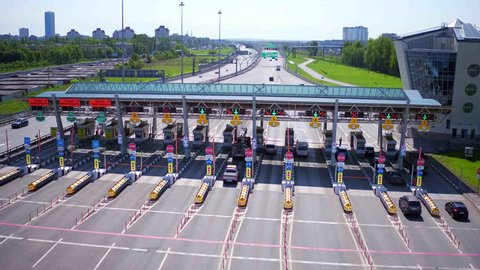 Aerial view of highway with Cars at modern toll road turnpike, entry fee pay gate