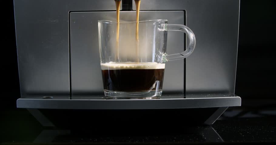 Making Fresh coffee going out from a coffee espresso machine. Shoot on Digital Cinema Camera in slow motion