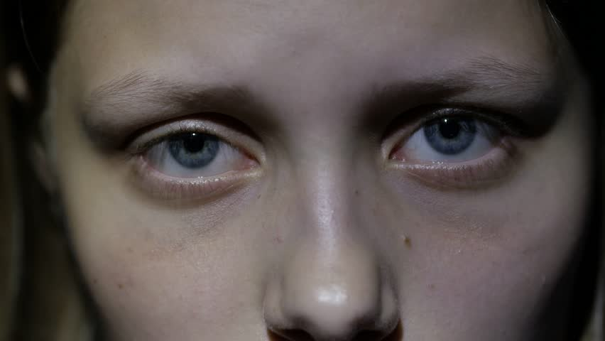 Sad teen girl, fear in her eyes. 4K UHD