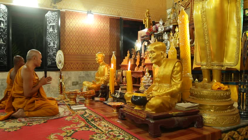 KO CHANG, TRAT/THAILAND - DECEMBER 5: Recitation of mantras by monks in a Buddhist monastery Wat Klong Prao on December 5, 2011 in Ko Chang, Thailand. On the occasion of the birth of King of Thailand.