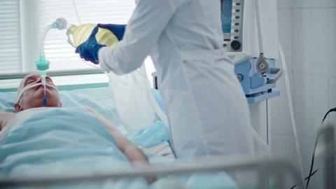 Medical Team Resuscitating Elderly Patient