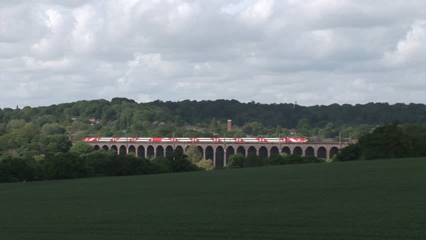 WELWYN, HERTFORDSHIRE, ENGLAND - MAY 22, 2016: A northbound Virgin East Coast passenger train heads north across Welwyn Viaduct in Hertfordshire.