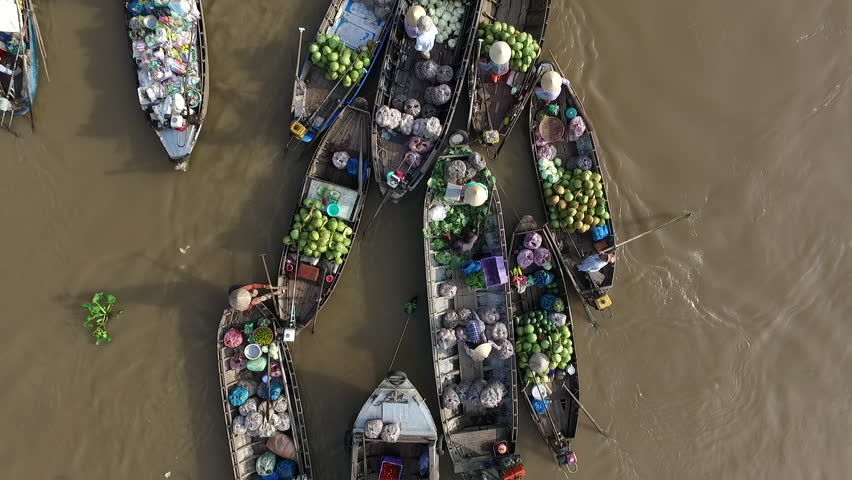 Aerial video from above, over a traditional floating market, in south of Vietnam