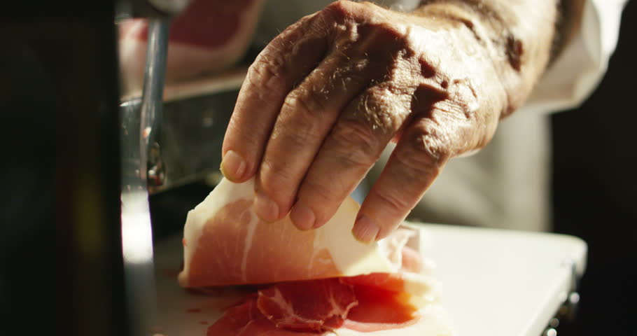Old hand experienced slices Parma ham Italian very fine and he savored the taste and goodness