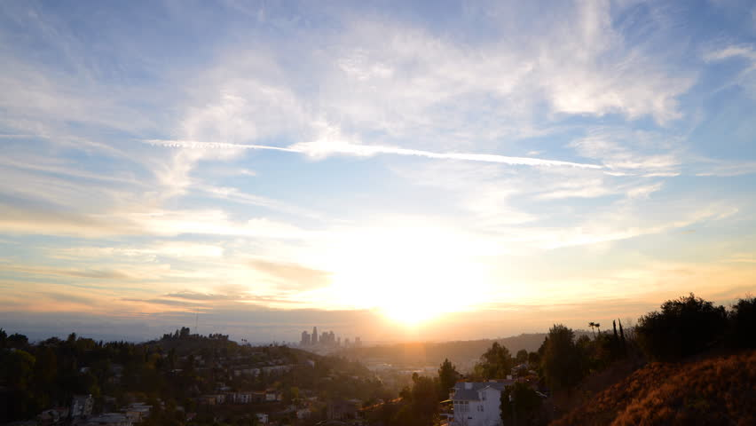 Time lapse footage of slow moving clouds at sunset over downtown Los Angeles skyline -Long Shot- | Shutterstock HD Video #17385769