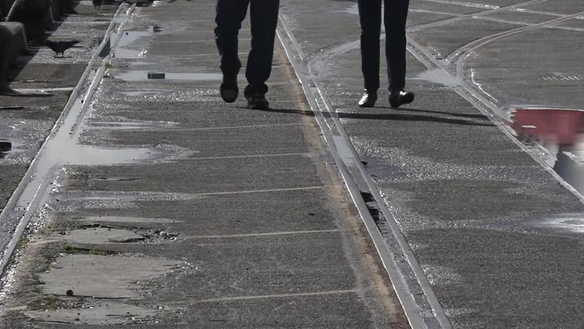 Silhouette of couple legs walks on a pier   Shutterstock HD Video #17412679