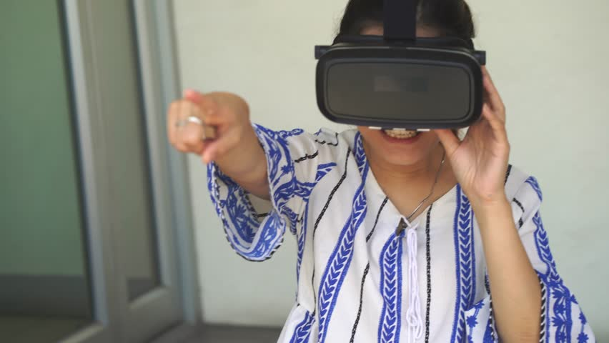 12ef9d0868c9 4k Asian woman getting experience using VR-headset glasses of virtual  reality.
