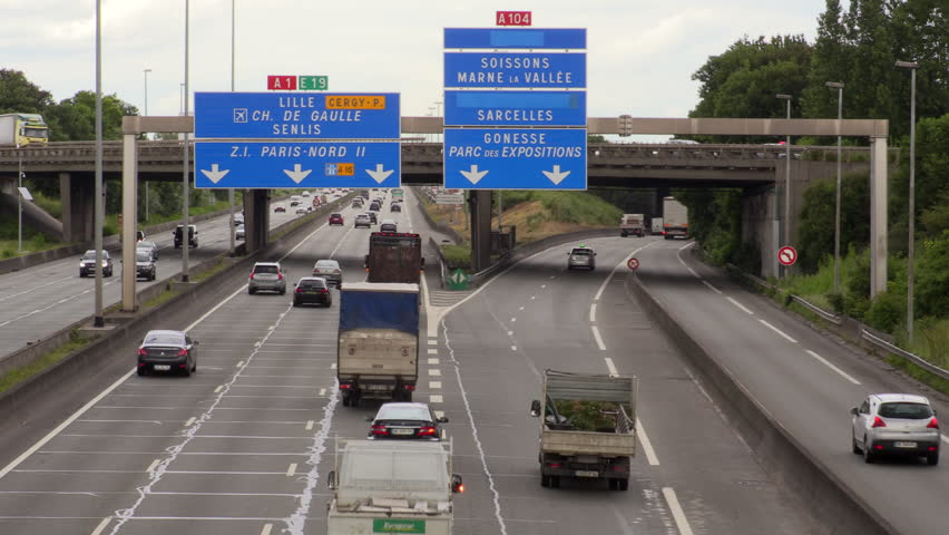 Paris, France - JUNE 14, 2016: Traffic and road users on french autoroute A1 just before Roissy airport.