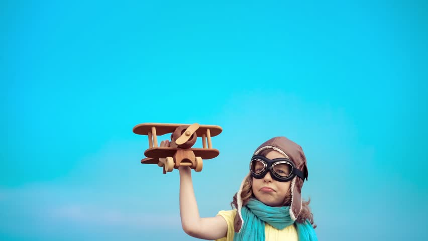 Happy kid with toy airplane. Child having fun outdoors. Kid playing in summer. Child against blue sky background. Travel and vacation concept. Imagination and freedom concept. 4K shooting Sony A7r II | Shutterstock HD Video #17464699