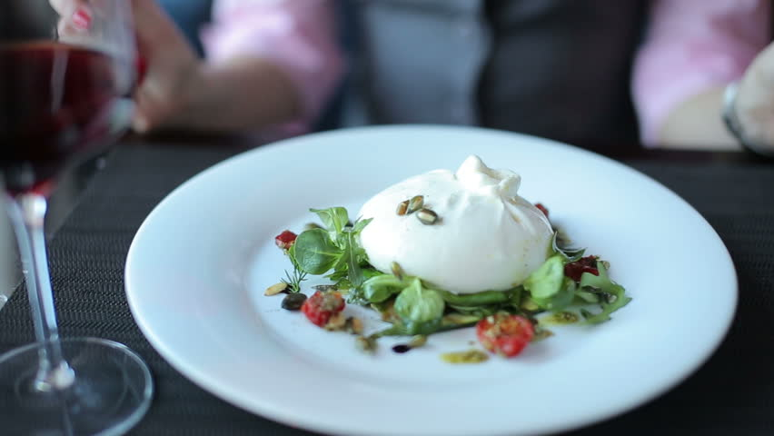 Burrata cheese served with red wine to client