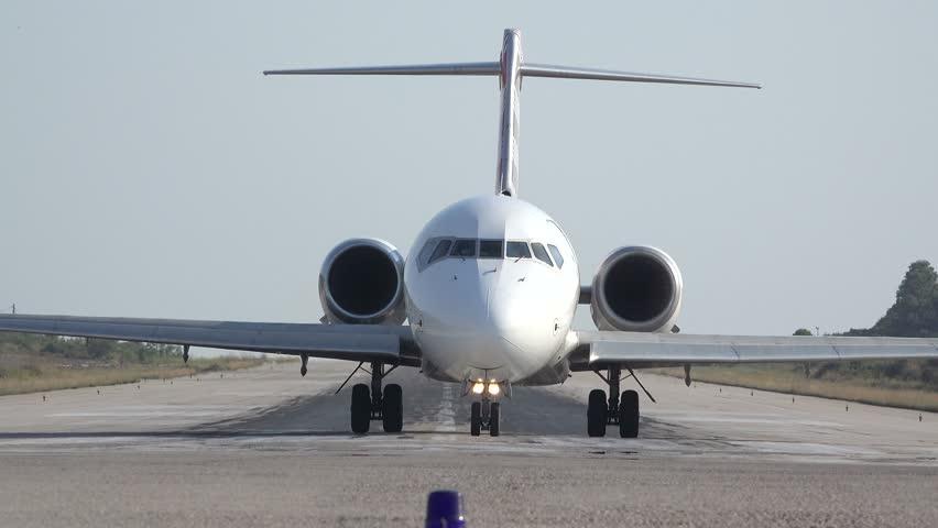 SKIATHOS, GREECE - AUGUST 15: Front view of big airplane on runway