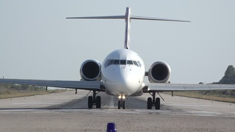 SKIATHOS, GREECE - AUGUST 15: Front view of big airplane on runway