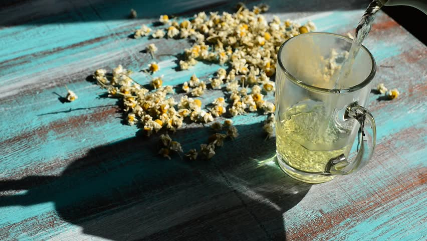Image result for Chamomile tea on blue wooden table